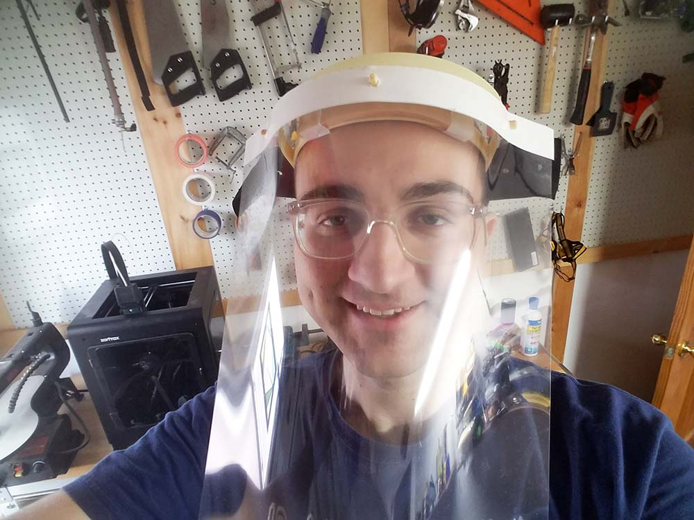 curt with face guard in workshop